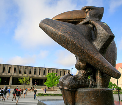 Wescoe with the Bronze Jayhawk Statue